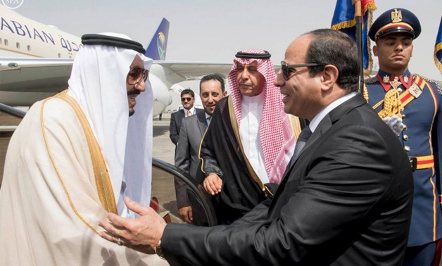 Egypt's President Abdel Fattah al-Sisi welcomes Saudi Arabia's King Salman in Cairo, Egypt, in this handout photo received April 7, 2016.