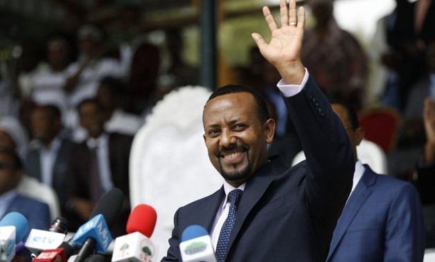 Ethiopian Prime Minister Abiy Ahmed reacts during his rally in Ambo, west of Addis Ababa, Ethiopia / AFP PHOTO / Zacharias Abubeker