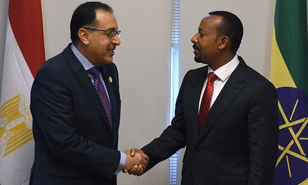 (L to R) - Prime Minister MostafaMadbouly shaking hands with Ethiopian counterpart Abiy Ahmed on the sidelines of the 11th Extraordinary Session of the Assembly of the African Union (AU) on Nov. 18, 2018 – Egypt Today/Solieman Al-Otaifi