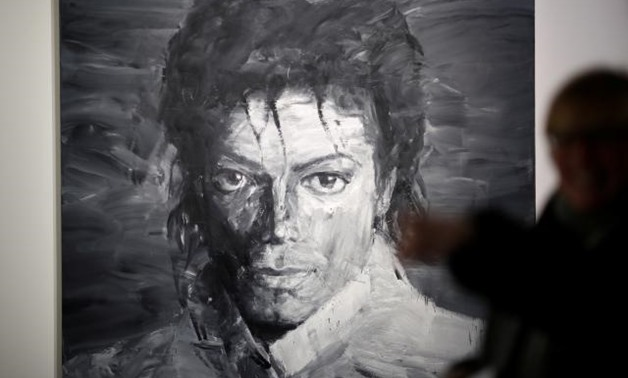 A portrait of Michael Jackson as King Philip II of Spain and an Andy Warhol print are among artworks on display at a show opening in Paris this week dedicated to the late pop star - Reuters.