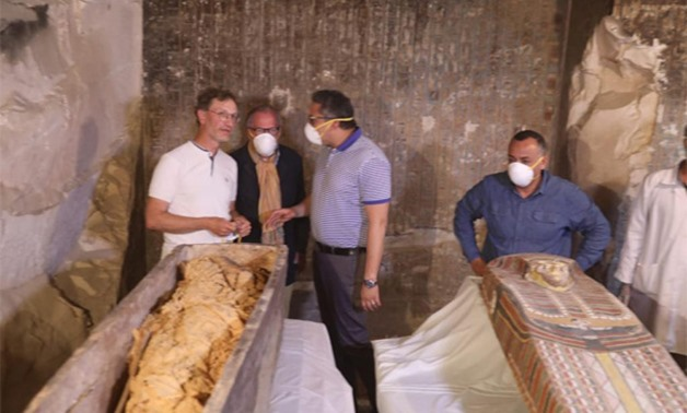 Anany examines the mummy inside the newly discovered sarcophagus.