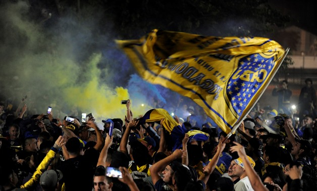Boca Juniors' fans cheer as their team heads on to Spain to play the Copa Libertadores final, in Buenos Aires, Argentina December 4, 2018. REUTERS/Stringer