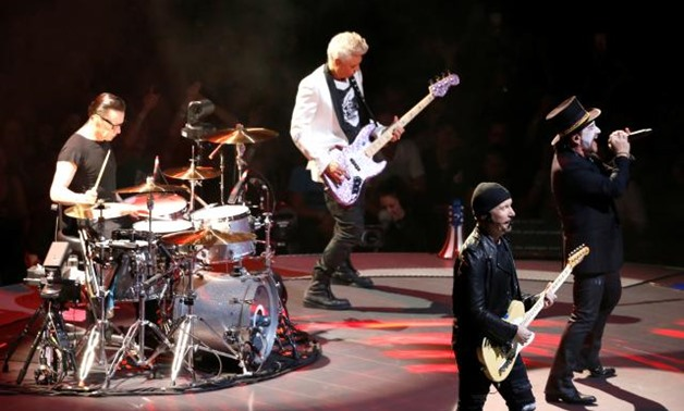 "FILE PHOTO: U2 performs during the band's ""Experience + Innocence"" tour at The Forum in Inglewood, California, U.S., May 16, 2018. REUTERS/Mario Anzuoni."