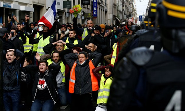 """Demonstrators clash with police during the """"yellow vests"""" protest against higher fuel prices, in Brussels, Belgium, December 8, 2018. REUTERS/Yves Herman"""