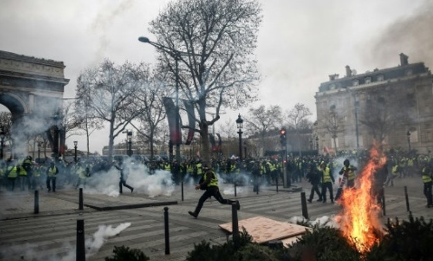 Protesters in Paris set fire to cars, burned barricades and smashed windows in pockets of violence, clad in their emblematic luminous safety jackets Protesters in Paris set fire to cars, burned barricades and smashed windows in pockets of violence, clad i