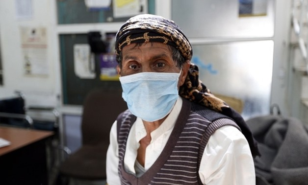 A Yemeni man suspected of being infected with cholera receives treatment at a hospital in Sanaa on 12 May (AFP)