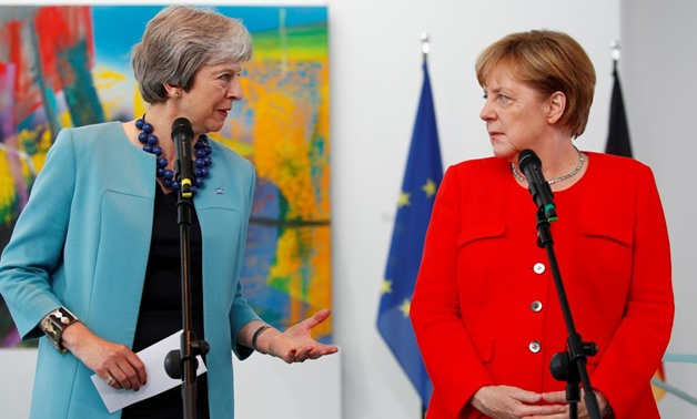FILE PHOTO: German Chancellor Angela Merkel receives Britain's Prime Minister Theresa May in Berlin, Germany, July 5 2018. REUTERS/Axel Schmidt/File Photo