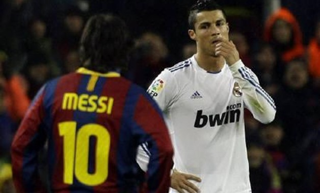 Real Madrid's Cristiano Ronaldo (L) reacts beside Barcelona's Leo Messi during their Spanish first division soccer match at Nou Camp stadium in Barcelona, November 29, 2010. REUTERS/Albert Gea/Files