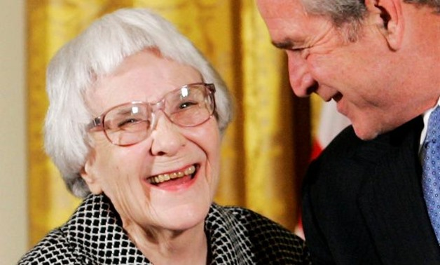 FILE PHOTO: U.S. President George W. Bush (R) before awarding the Presidential Medal of Freedom to American novelist Harper Lee (L) in the East Room of the White House, in this November 5, 2007. REUTERS/Larry Downing.