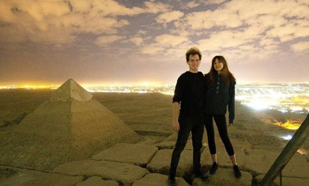 Danish Photographer Andreas Hvid with his girl friend allegedly atop of Giza Pyramid - screenshot of video