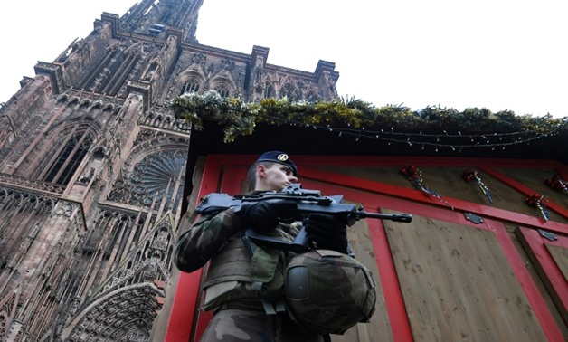 A French soldier in front of a boarded-up Christmas market stall outside the cathedral in Strasbourg, eastern France, on Wednesday cathedral in eastern