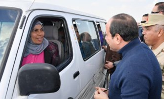 FILE - President Abdel Fatah al-Sisi met with a female minibus driver, Nehmedo Saeed on Thursday, during his tour of Egypt's New Administrative Capital.