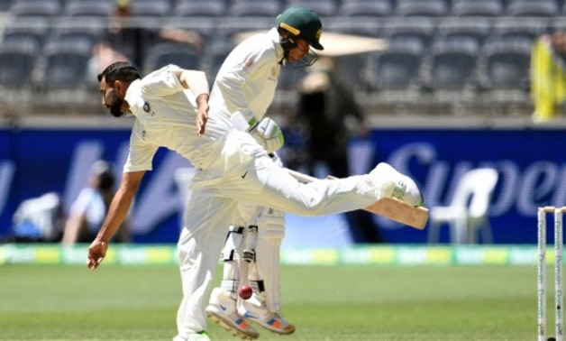 India's Mohammed Shami attempts to field as Australia's batsman Usman Khawaja runs back to the crease India's Mohammed Shami attempts to field as Australia's batsman Usman Khawaja runs back to the crease AFP