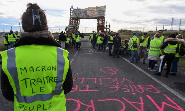 """Death toll in French """"yellow vest"""" protests rises to nine"""