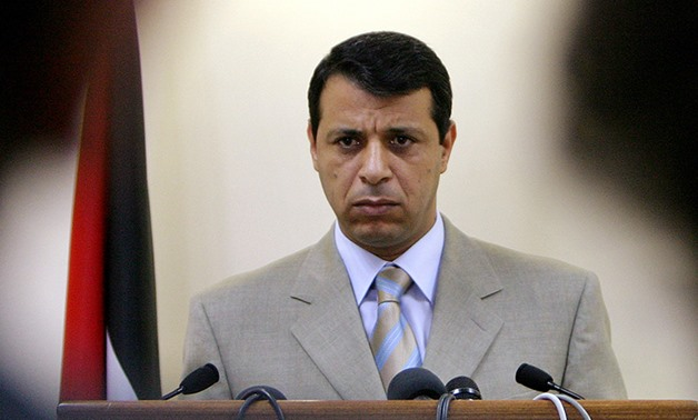 FILE - Mohammed Dahlan speaks to media in the West Bank city of Ramallah, July 5, 2005 - Reuters