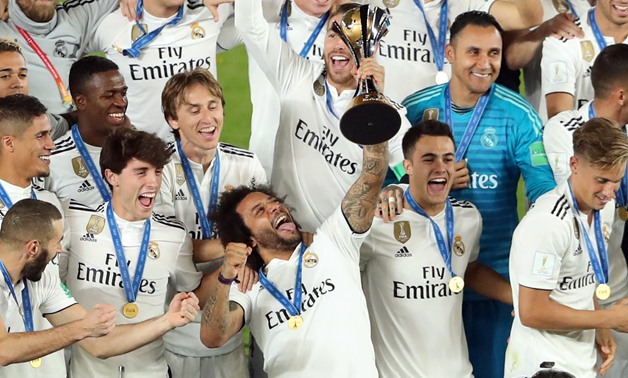 Soccer Football - Club World Cup - Final - Real Madrid v Al Ain - Zayed Sports City Stadium, Abu Dhabi, United Arab Emirates - December 22, 2018 Real Madrid players celebrate with the trophy after winning the Club World Cup REUTERS/Ahmed Jadallah