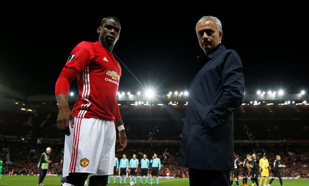 FILE PHOTO: Britain Soccer Football - Manchester United v FC Zorya Luhansk - UEFA Europa League Group Stage - Group A - Old Trafford, Manchester, England - 29/9/16 Manchester United manager Jose Mourinho with Paul Pogba before the match Action Images via
