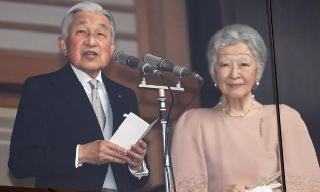 Japan emperor draws huge birthday crowd before abdication next year - Reuters.