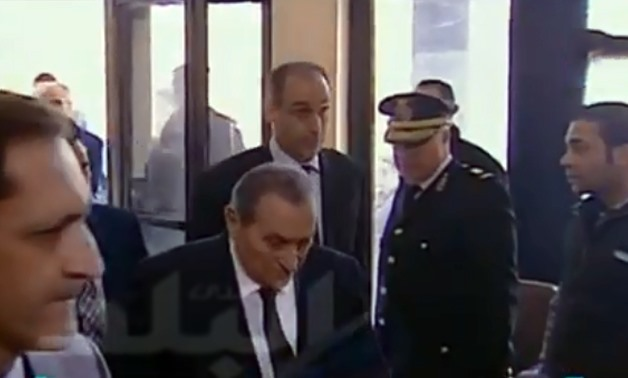 Former president Hosni Mubarak entering the court - Still image from a live broadcast