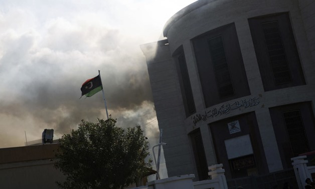 Smoke rises shortly after an attack on the foreign ministry building, in Tripoli, Libya, Tuesday, Dec, 25, 2018. (AP)
