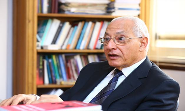 FILE - Former Dean of Political Science and Economics Faculty at Cairo University  and former Minister of Youth Ali El Din Helal - Hussein Talal