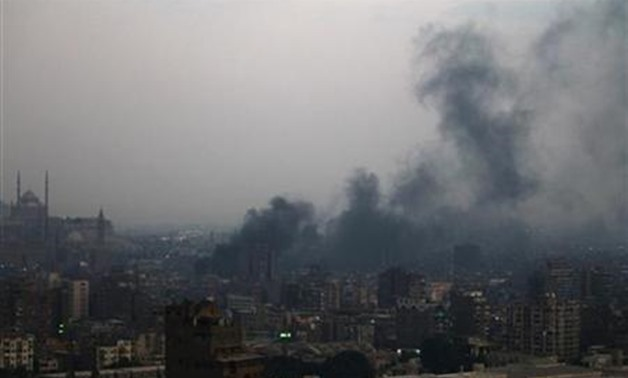 Smoke rises from burning garbage in downtown Cairo October 20, 2011. Environmentalists blame the burning of agricultural waste, mostly rice straw - Reuters