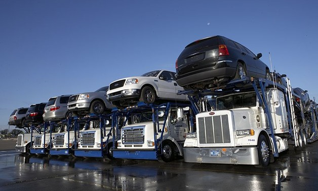 FIle photo: Trucks carrying cars - Wikimedia Commons/Transport Auto