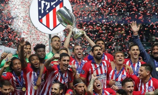 Soccer Football - Super Cup - Real Madrid v Atletico Madrid - Lillekula Stadium, Tallinn, Estonia - August 15, 2018 Atletico Madrid celebrate with the trophy after winning the Super Cup REUTERS/Maxim Shemetov