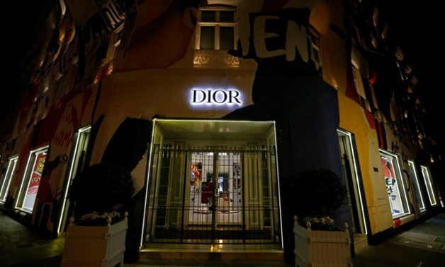 FILE PHOTO: The Dior logo is seen on the facade of a shop in Paris, France, August 5, 2018. Picture taken August 5, 2018. REUTERS/Regis Duvignau