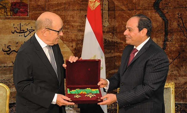 President Abdel Fatah al-Sisi (R) grants French Minister of Defense Jean-Yves Le Drian Order of the Republic - Press photo