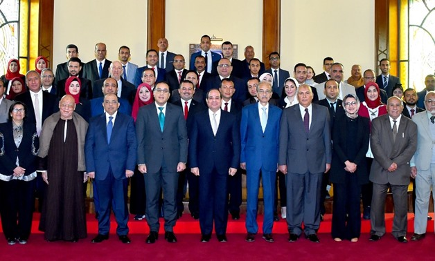 President Abdel Fattah al Sisi with Prime Minister Mostafa Madbouli and raft of ministers - Press photo