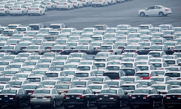 FILE PHOTO: Newly manufactured cars are seen at the automobile terminal in the port of Dalian, Liaoning province, China July 9, 2018. REUTERS/Stringer/File Photo