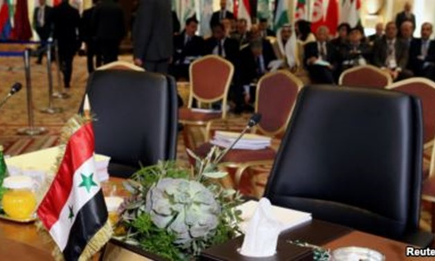The empty seat of Syria is seen during a pre Arab Economic and Social Development summit
