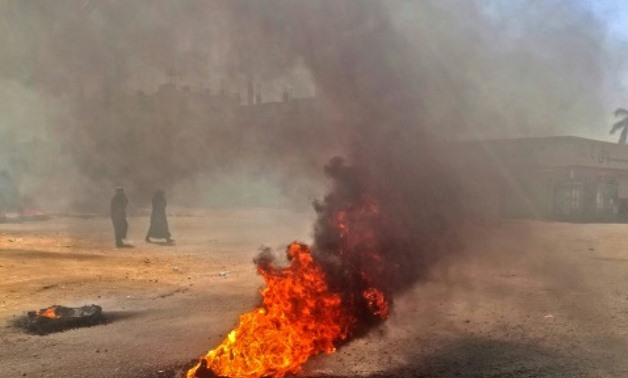 In this file photo, Sudanese protestors burn tyres during an anti-government demonstration on January 18, 2019 in the capital Khartoum AFP/File