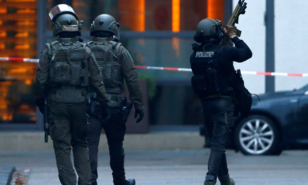 REFILE - CORRECTING GRAMMAR German special police leaves the area after shots have been fired in building near the main train station Cologne, Germany, January 4, 2019. REUTERS/Thilo Schmuelgen