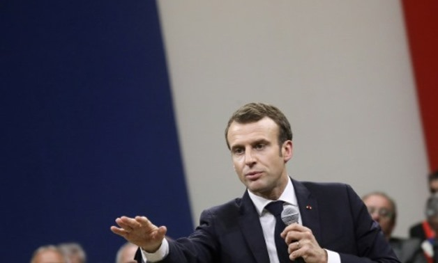 """President Emmanuel Macron is holding dozens of town hall-style debates across France in a bid to defuse """"yellow vest"""" anger POOL/AFP/File"""