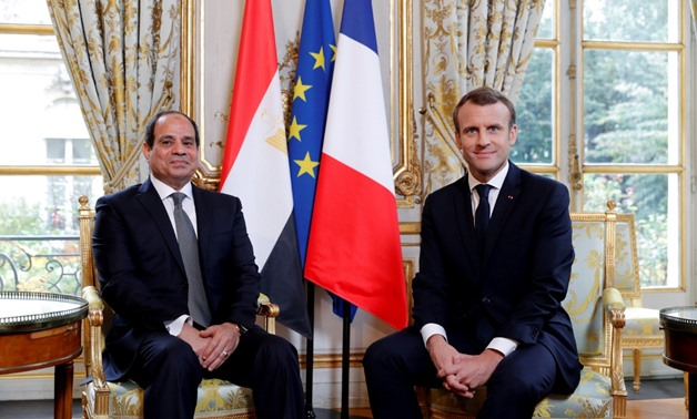 FILE PHOTO: French President Emmanuel Macron meets with Egyptian President Abdel Fattah al-Sisi at the Elysee Palace, in Paris, France, October 24, 2017. REUTERS/Philippe Wojazer/File Photo