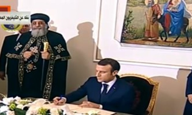 French President Emmanuel Macron during his visit to the Orthodox Cathedral premises in Cairo's Abbassiya district - Press Photo