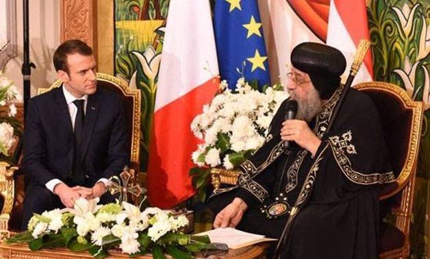 French President Emmanuel Macron met with Pope Tawadros II of Alexandria at Coptic Orthodox Cathedral in Cairo's Abbassia District, Egypt. January 29, 2019. TV screenshot.
