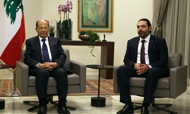 Lebanon's President Michel Aoun and Prime Minister-designate Saad al Hariri meet ahead of a new government announcement at the presidential palace in Baabda Leban