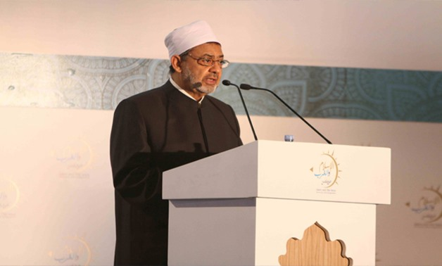 FILE - Grand Imam and Al Azhar Sheikh Ahmed al-Tayeb delivers a speech in a conference in Cairo, Egypt.