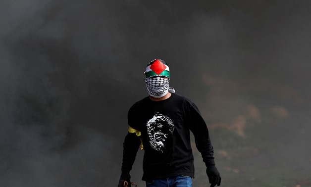 A Palestinian demonstrator is seen during clashes with Israeli forces at a protest in al-Mughayer village near Ramallah, in the Israeli-occupied West Bank, February 1, 2019. REUTERS/Mohamad Torokman
