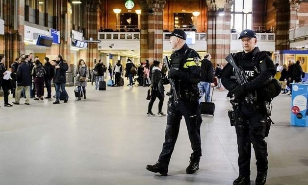 Dutch officers carry out extra patrols at the Central Station in Amsterdam, The Netherlands - REUTERS