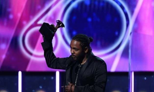 Kendrick Lamar -- shown receiving the Grammy for Best Rap Album for DAMN. during the 60th Annual Grammy Awards show on January 28, 2018 -- is the top nominee this year Kendrick Lamar -- shown receiving the Grammy for Best Rap Album for DAMN. during the 60