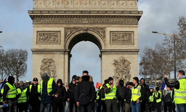 Gonzalo Fuentes, Reuters | Protesters wearing yellow vests take part in a demonstration in Paris on February 9.