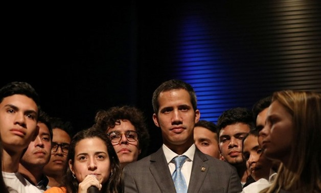 Venezuelan opposition leader Juan Guaido, who many nations have recognized as the country's rightful interim ruler, is seen with students in Caracas, Venezuela February 11, 2019. REUTERS/Andres Martinez CasaresREUTERS