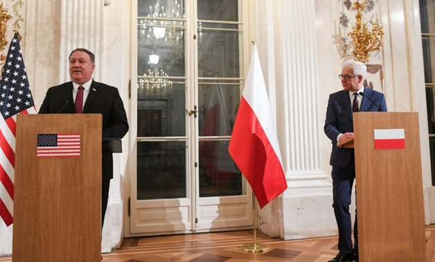 Janek Skarzynski, AFP | Polish Foreign Minister Jacek Czaputowicz (R) and US Secretary of State Mike Pompeo give a joint press conference on February 12, 2019 in Warsaw.