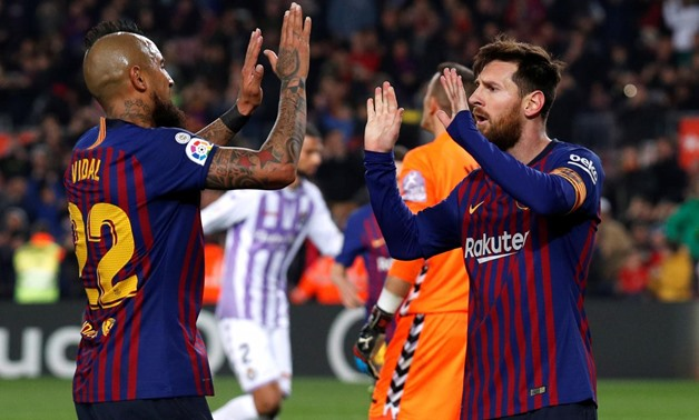 February 16, 2019 Barcelona's Lionel Messi celebrates scoring their first goal with Arturo Vidal REUTERS/Albert Gea