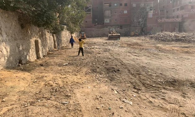 FILE- Bulldozer removes slums in the vicinity of Jewish cemeteries of Bassatine in Cairo- Photo courtesy of the Jewish Community in Cairo's Facebook page.