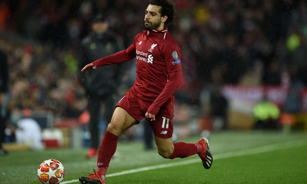 Liverpool's Egyptian midfielder Mohamed Salah says it's his dream to win the Premier League. - AFP